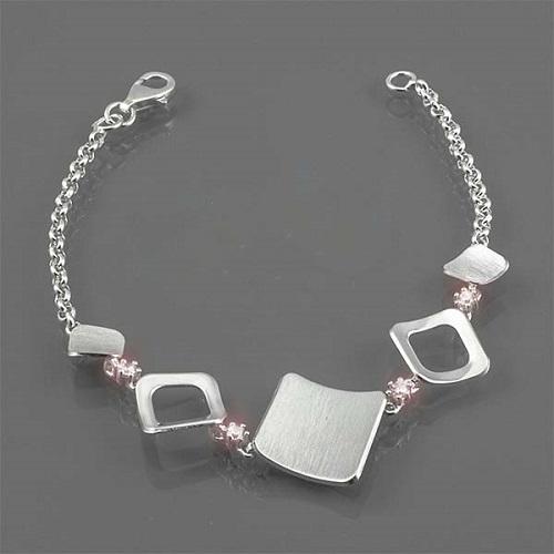 Dámský stříbrný náramek s bílými zirkony AUS10426