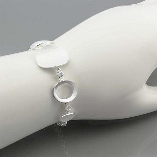 Dámský stříbrný náramek se zirkony AUS10455